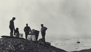 Charlie Thomsen, his daughter Annie, Natkusiak, and Peter Bernard caching supplies just east of Sachs Harbour, August 27, 1914