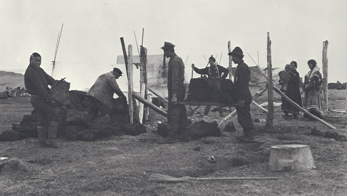 Laying the sod foundation of the house at Mary Sachs, September 8, 1914. G.H. Wilkins photo.