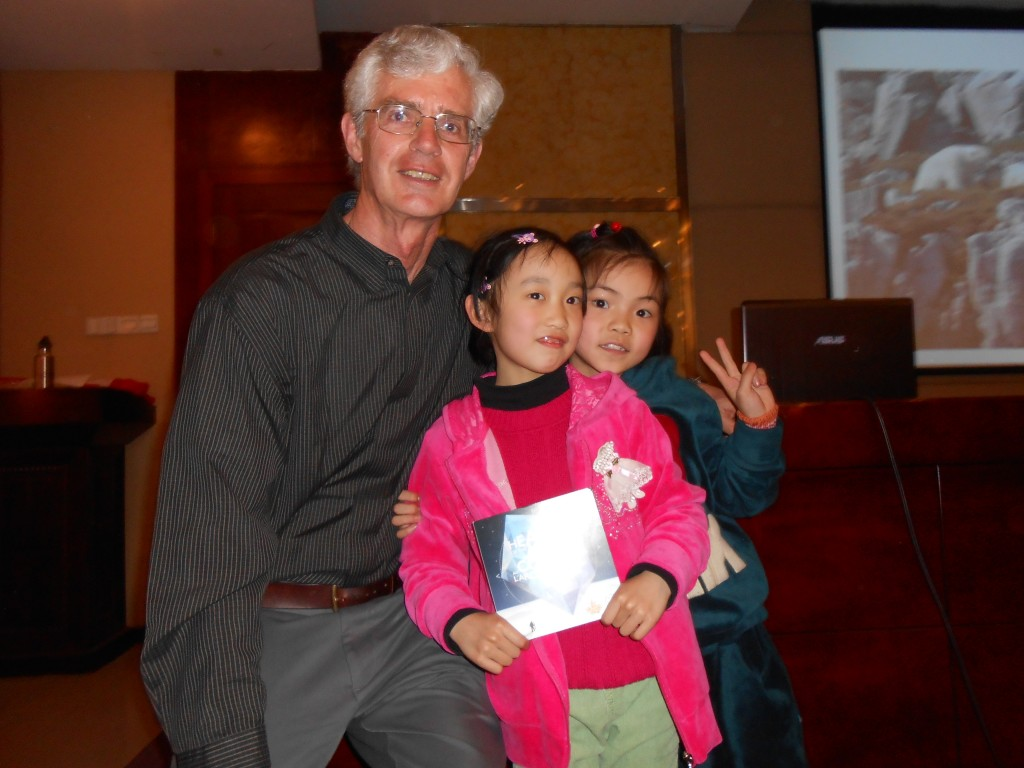 David with the young girl who won the CAE coins.
