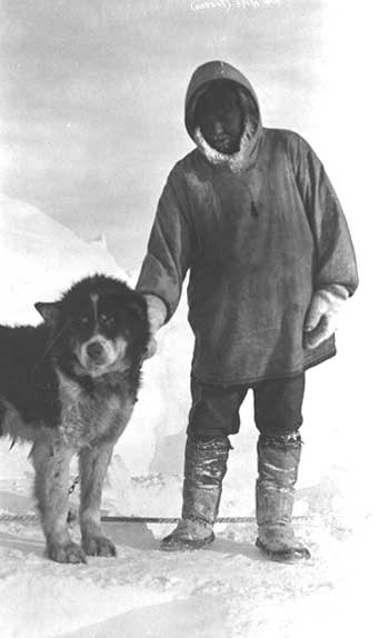 Natkusiak, known as Billy Banksland, with his big dog, Mike, north of Banks Island, 1916.